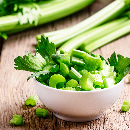 Bowl filled with chopped celery stalks